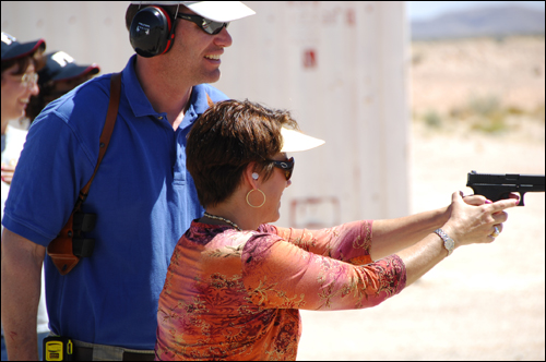 A member of the El Paso Citizens' Academy takes aim during target practice. Citizens' Academy classes generally meet 10 times for three hours each session and are taught by Special Agents in Charge of a field office and by their senior managers and senior agent experts.