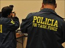 Guard Shack: Task Force Members Book a Suspect -