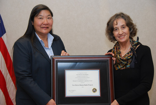 Albuquerque Special Agent in Charge Lee presents the 2012 Director's Community Leadership Award to Regina Turner (12/12/12)