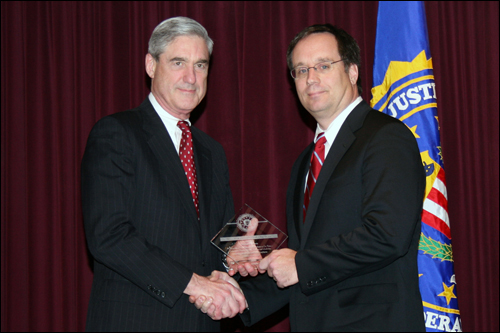 Director Mueller and Michael P. Norris