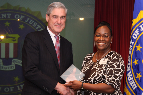 Director Mueller and Veronica McMillian