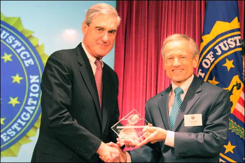 Director Mueller and John Z. Hecker