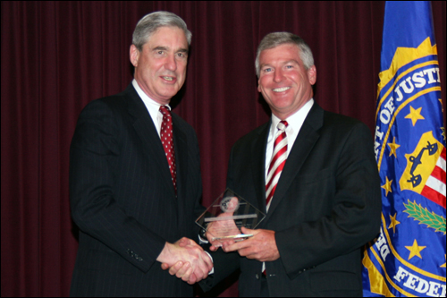 Director Mueller and Timothy J. Davlin
