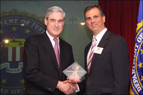 Director Mueller and Doug Evans