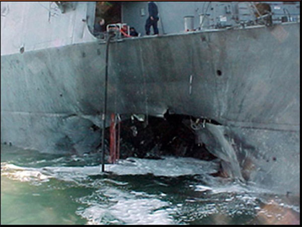 A photo of the 40-foot hole in the side of the U.S.S. Cole