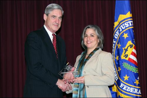 Director Mueller and Isabel Rubio