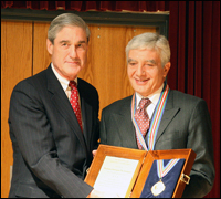 Director Mueller awarded Italian National Police Chief Giovanni De Gennero the FBI's Medal of Meritorious Achievement.