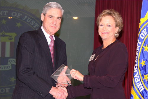 Director Mueller and Judy Wagner
