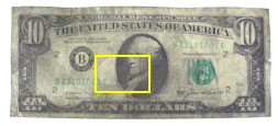 Figure 2A is a photograph of a chemically treated latent fingerprint developed on the dark region of a counterfeit $10 bill.