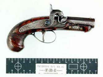 Lincoln's assassination pistol with evidence scale