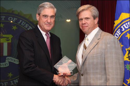 Director Mueller and Rafael Goyeneche, III