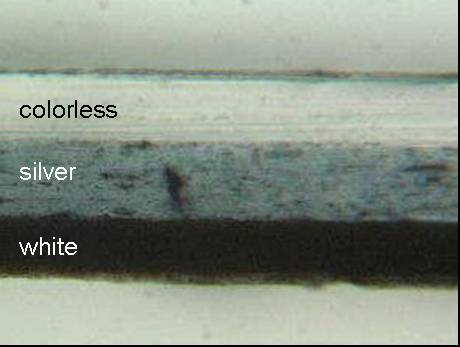 Figure 1 shows the micrograph of the cross section of tape Sample 55 magnified 250 times. The backing appears to have three layers.