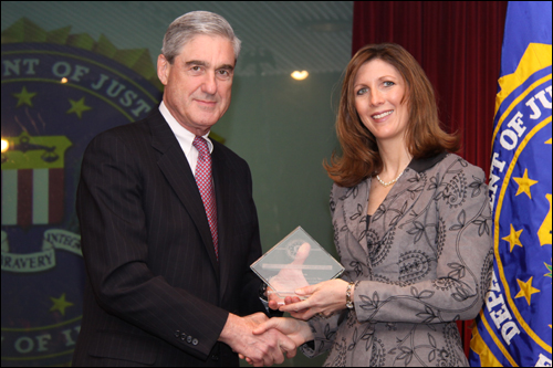 Director Mueller and Liberty Roberts