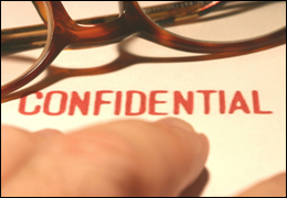 """Hands and Glasses on """"Confidential"""" Folder (Stock Image)"""
