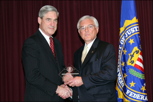 Director Mueller and John R. McConnaughey