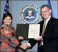Stephanie Dietrich with Boston Special Agent in Charge Ken Kaiser