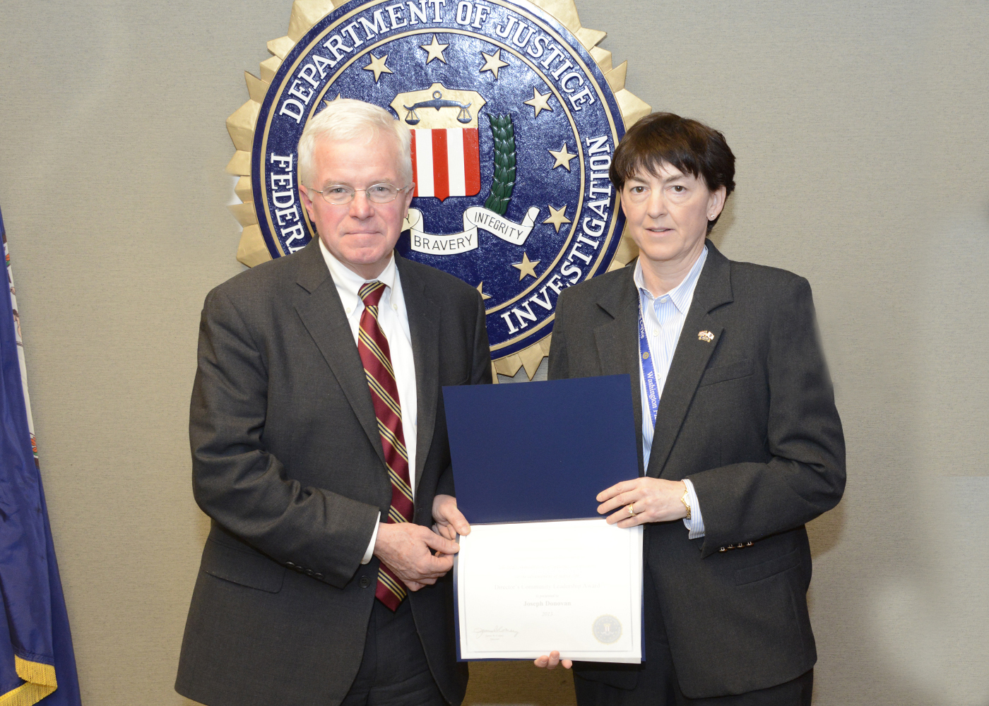 Assistant Director in Charge Valerie Parlave with Joseph Donovan (12/20/13)