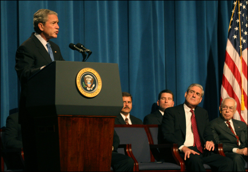 President Bush Speaks at New Agent Graduation in October 2008 as Director Mueller and Attorney General Mukasey Look On