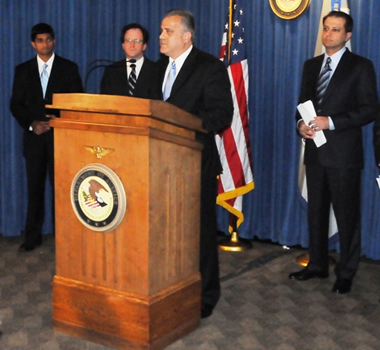 A/ADIC George Venizelos speaking at the press conference with United States Attorney Preet Bharara (far right)  Photo Credit: Rebecca Callahan, FBI