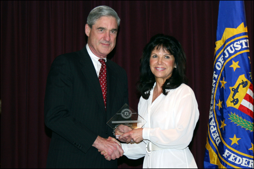 Director Mueller and Susan A. WhiteHorse