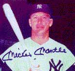 Signed photograph of professional baseball player Mickey Mantle in uniform and holding a bat.