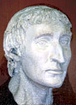 Photograph of a detailed plaster model of Anital Simon's head, hair and eyebrows added, with the portrait superimposed to show how closely the features match
