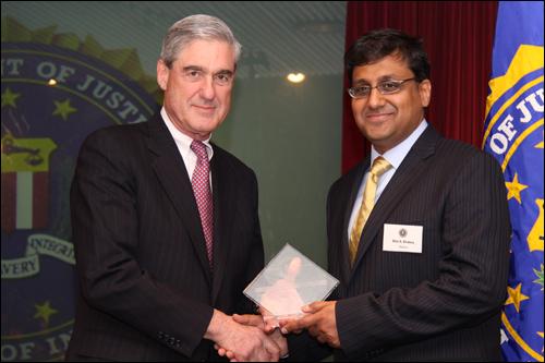 Director Mueller and Bilal A. Khaleeq