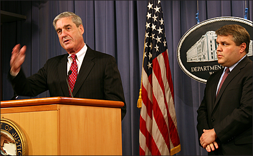 Director Mueller speaks to reporters during a press conference announcing more than 400 arrests related to Operation Malicious Mortgage. With Mueller is Deputy Attorney General Mark Filip.