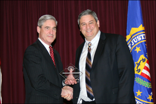 Director Mueller and David B. Alvarez