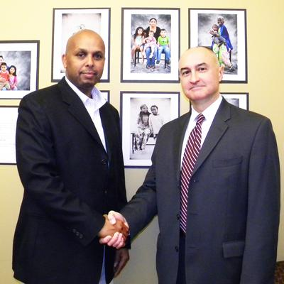 Portland Special Agent in Charge Greg Fowler and Musse Olol, chairman and spokesperson for the Somali American Council of Oregon at presentation of FBI Director's Community Leadership Award.