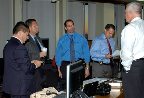 Special Agent in Charge Diego Rodriguez (left) meets with agents in the New York FBI Command Post during arrest operations this morning Photo Credit: FBI