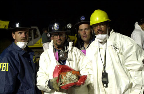 A photo of personnel with the cockpit voice recorder recovered from Flight 93.