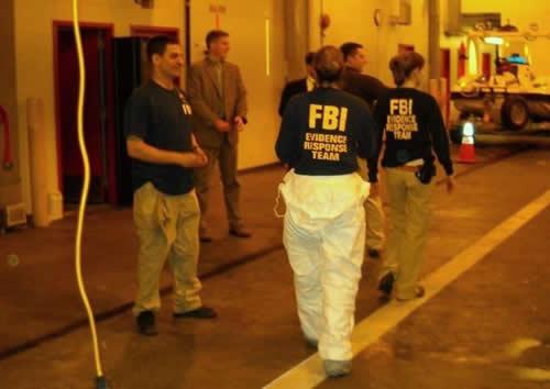 FBI New York's Evidence Response Team prepares to search Faisal Shahzad's car at JFK Airport