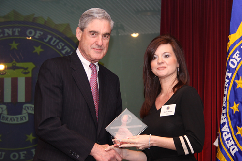 Director Mueller and Michelle Riggs