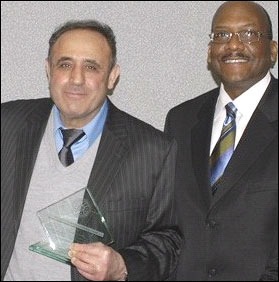 Dr. Tomeh (left) with Atlanta Special Agent in Charge Gregory Jones