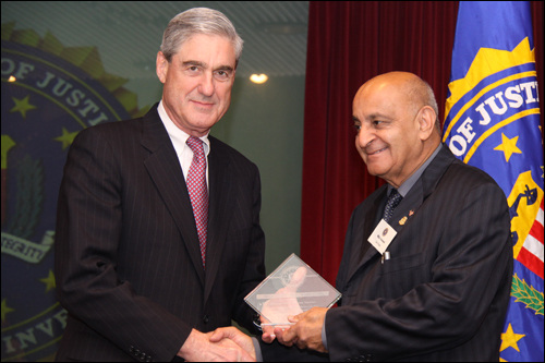 "Director Mueller and Manohar ""Mike"" Vaswani"