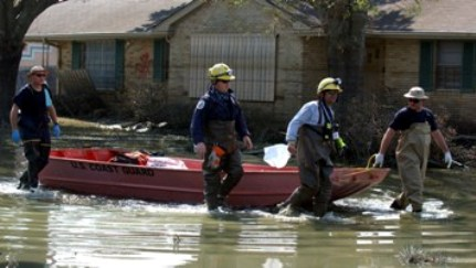 Hurricane Katrina Rescue Workers in Flooded Neighborhood (FEMA Photo)