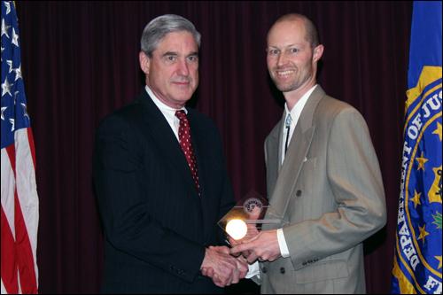Director Mueller and Dr. John E. Ratmeyer