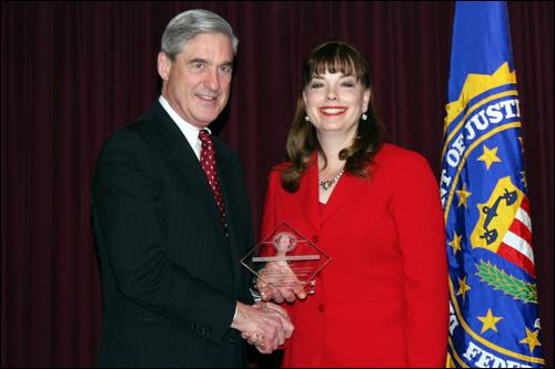 Director Mueller and Susan Oliva