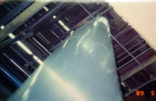 Figure 2: A photograph of a plastic column reaching several stories high that will be transformed into a bag