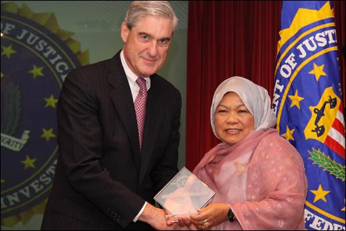 Director Mueller and Josefina Salma Ahmad
