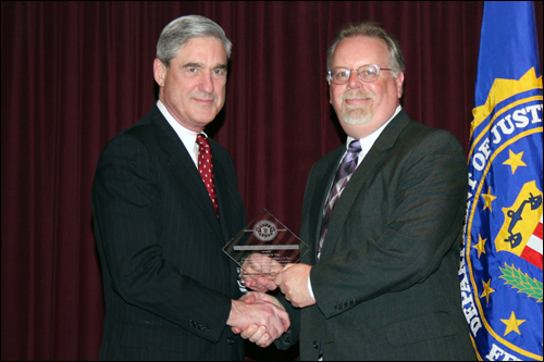 Director Mueller and Charles R. Tilby