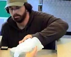 """Surveillance photo of man dubbed the """"Bearded Bandit,"""" who is suspected of robbing four banks in Rhode Island and Massachusetts."""