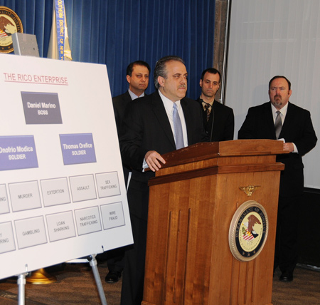 Special Agent in Charge George Venizelos speaking on the Gambino Arrests. Behind, from left, U.S. Attorney Preet Bharara, Special Agents Paul Harris and Gerard Conrad. Photo Credit: Rebecca Callahan, FBI