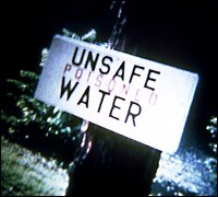 "Sign Saying ""Unsafe Poisoned Water"" (EPA Photo)"