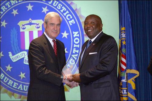 robert-e-Norfolk field office Director's Community Leadership Award 2011.jpg