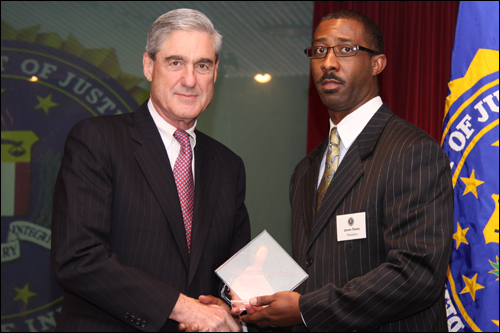 Director Mueller and Jerome Chaney