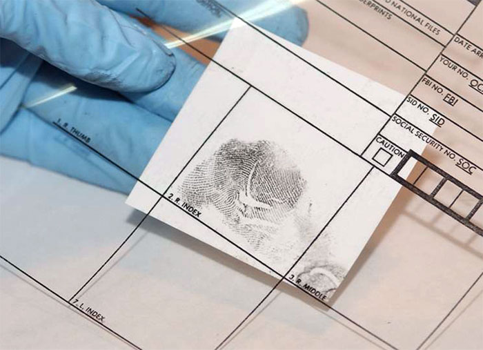 Figure 9 is an adhesive lifter affixed to the correct fingerprint block of a transparent ten-print card.