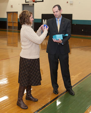 Principal Dr. Rosenbach Accepts the SOS Award Award from Charlotte Assistant Special Agent in Charge Jewell