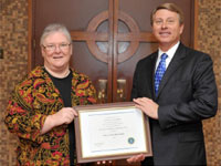 Acting Special Agent in Charge Moss Presents Award to Sister Guenther (12/12/12)
